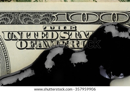 Oil petrol spot on dollar banknote money - stock photo