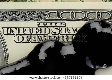 Oil petrol spot on dollar banknote money - stock photo