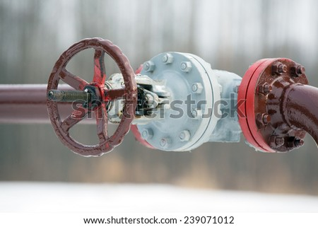 Oil Pipeline Valve outdoors - stock photo