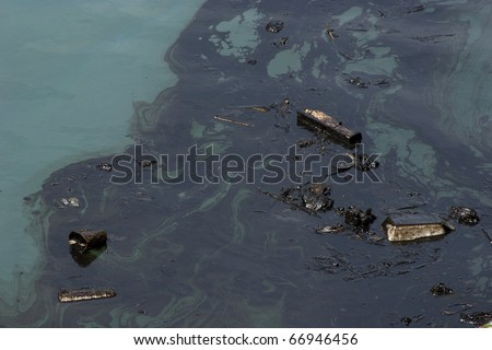 oil polution on the ocean water - stock photo