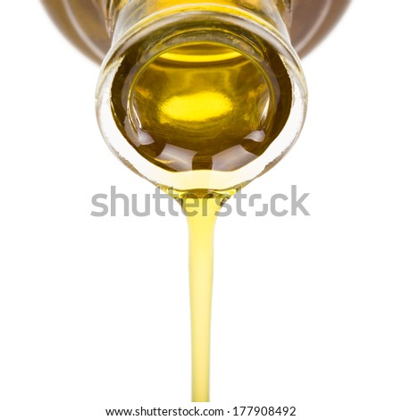 Oil pouring from bottle - stock photo