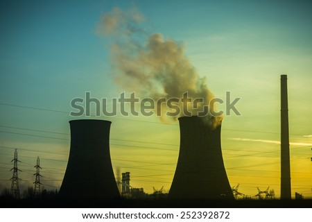 Oil power plant at sunset. - stock photo