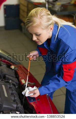 oil pressure is measured in the car. with the dipstick the correct oil level is checked - stock photo