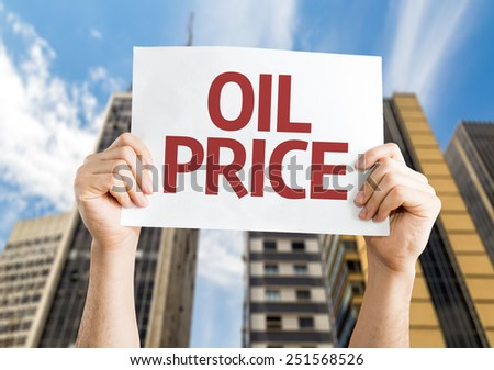 Oil Price card with urban background - stock photo