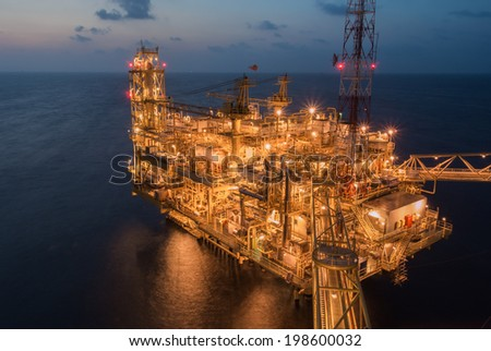 oil production platform on the sea - stock photo