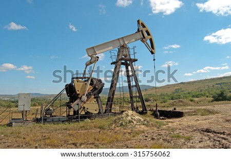 oil pump in the Carpathian mountains - stock photo