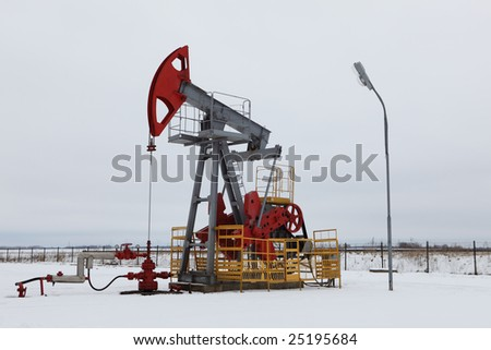 Oil pump in winter - stock photo
