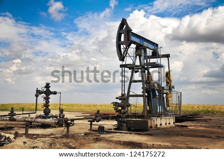 Oil pump jack - stock photo