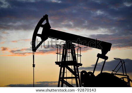 Oil pump jack - stock photo