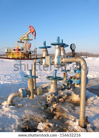 Oil pump jack in work. Oil industry and gas industry in West Siberia. Latch on a oil well  - stock photo