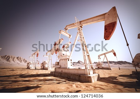 Oil pump jack rocking. - stock photo