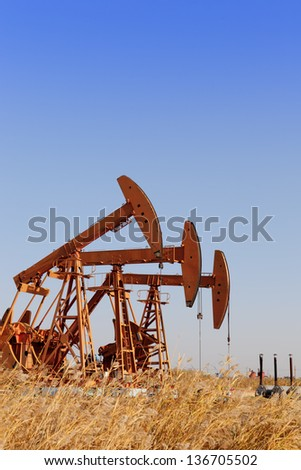 Oil pump jacks (HDR) - stock photo