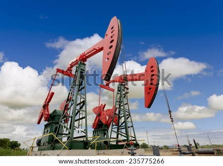 oil pump jacks on a oil field  - stock photo