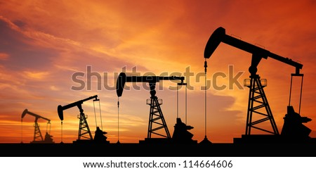 Oil pump oil rig energy industrial machine for petroleum in the sunset background for design