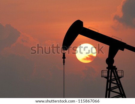 Oil pump oil rig energy industrial machine for petroleum in the sunset background for design - stock photo