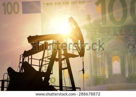 Oil pump on background of euro banknote - stock photo