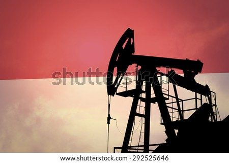 Oil pump on background of flag of Indonesia - stock photo