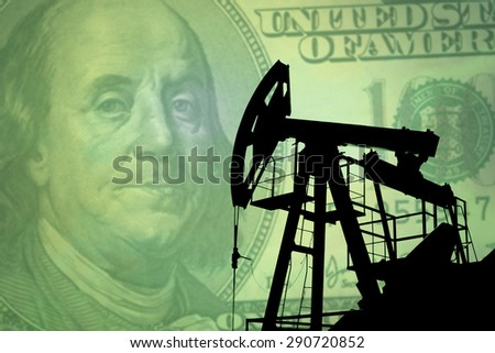 Oil pump on background of US dollar - stock photo