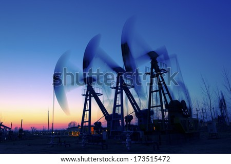 Oil Pump on orange sunset  - stock photo