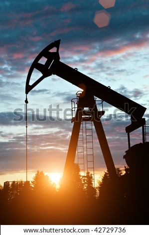 oil pump on sunset background - stock photo