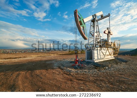 Oil pumping station in the early spring - stock photo