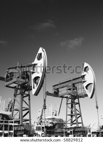 Oil pumps in Siberia. Black and white photo - stock photo