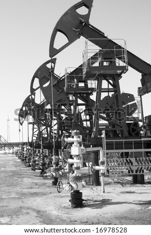 Oil pumps in West Siberia. Oil industry equipment. Black and white - stock photo