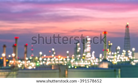 Oil refinery and oil thank in sunset background ,  petrochemical plant with out of focus - stock photo