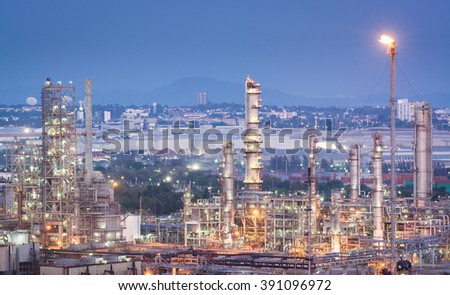 Oil refinery and petrochemical plant at evening - Petroleum - stock photo