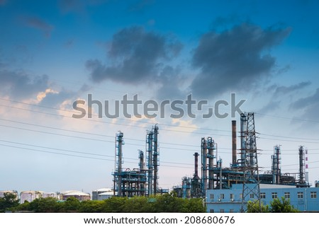oil refinery at dusk ,industrial landscape background  - stock photo