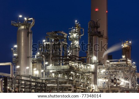 Oil refinery at night in Hamburg, Germany - stock photo