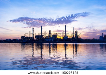 Oil refinery at sun rise time - stock photo