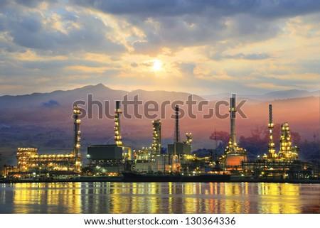 Oil refinery at sunrise - stock photo