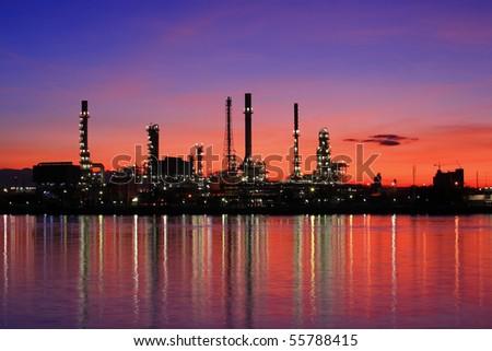 Oil refinery at twilight,Chao Phraya river, Thailand - stock photo