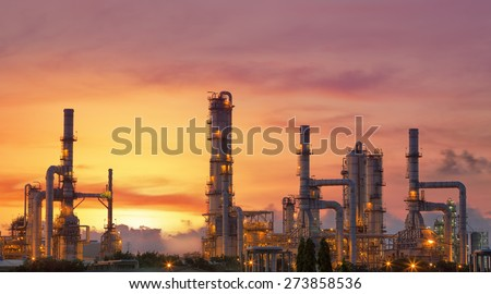 Oil refinery at twilight sky, close up to pipe line - stock photo