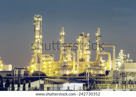 Oil refinery at twilight, vintage color tone.