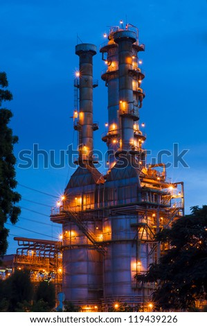 Oil refinery at twilight with blue sky - stock photo