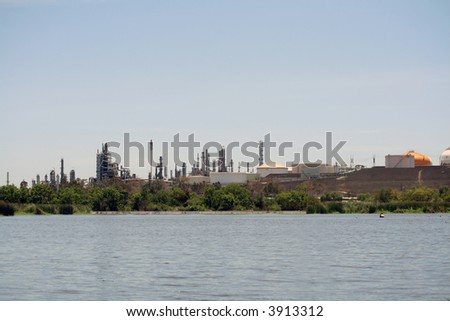oil refinery by a park - stock photo