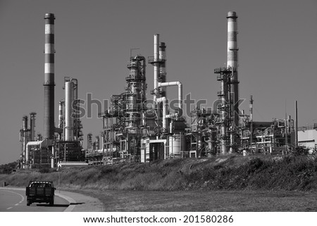 Oil refinery, Europe. Polluting energy. Black and white shoot