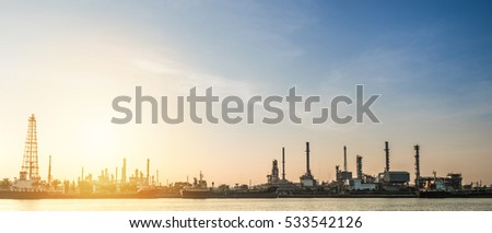 Oil refinery factory and logistic over sunrise Bangkok Thailand,with silhouette