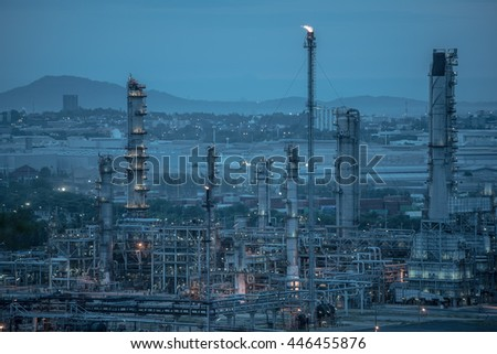 Oil Refinery factory at sunrise, petrochemical plant, Chemical Industry,  Oil refinery plant at twilight, petrochemical plant in night time, oil refinery industry plant along twilight morning - stock photo