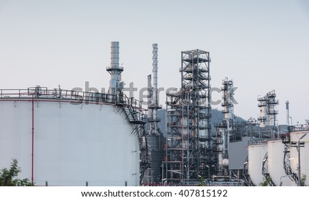 Oil Refinery factory at sunset, Petroleum, petrochemical plant - stock photo