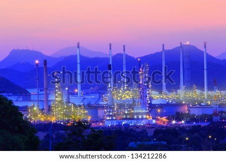 Oil Refinery factory at twilight - stock photo