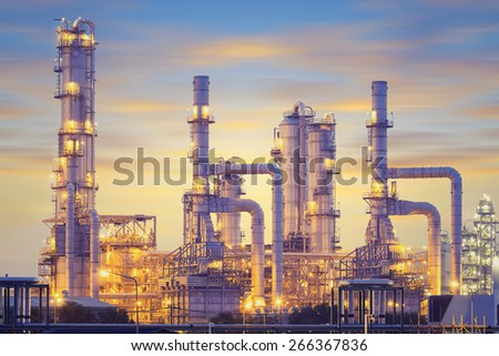 Oil refinery factory at twilight, blue color tone. - stock photo