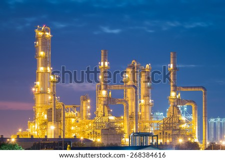 Oil refinery factory at twilight with sky background. - stock photo