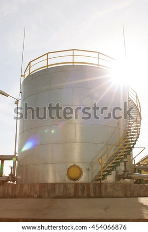 Oil refinery factory, industrial petrol tanks - stock photo
