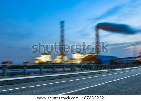 oil refinery factory under the cloudy sky,motion blurred. - stock photo