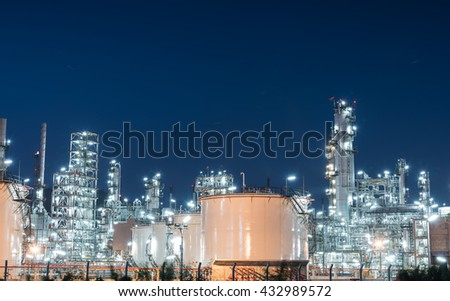 Oil refinery gas industry plant of petroleum industry production at sunset - stock photo
