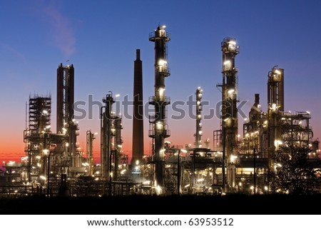 Oil refinery in Schleswig-Holstein, Germany just after sunset, petrochemical industry night scene - stock photo