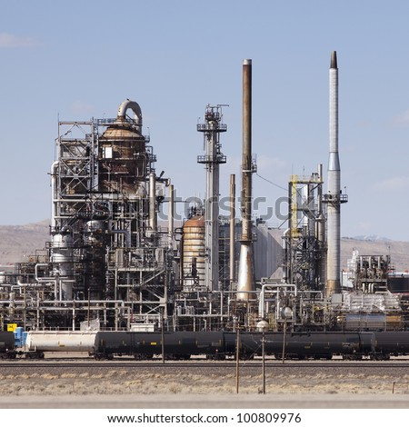 Oil Refinery in Sinclair Wyoming with train - stock photo